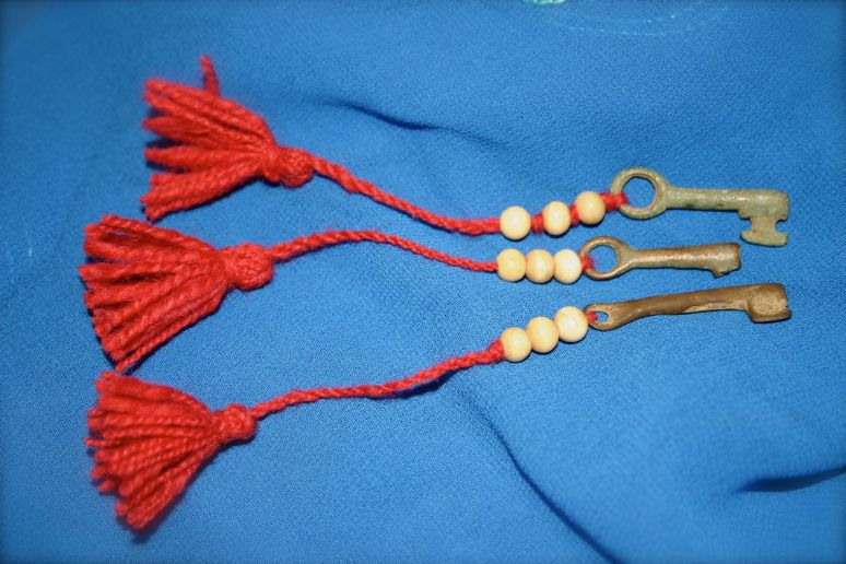 Hand forged medieval casket keys, with bone beads, hand spun and hand twined cord, and a tassel.
